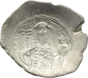 R/ Alexius I, Comnenus (1081-1118).  AR Histamenon Nomisma, Constantinople mint. Obv. Christ enthroned facing, raising right hand in benediction and holding in left book of Gospels. Rev. Bust facing, bearded, holding sceptre surmounted by pelleted star and globus cruciger. R. 2062. Sear 1893. AR. g. 3.76  mm. 29.00  R. Rare and in excellent condition for the issue. Good VF.