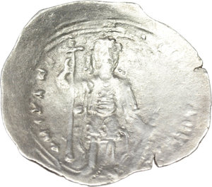 R/ Alexius I, Comnenus (1081-1118).  AR Miliaresion, Constantinople mint. Obv. The Virgin orans standing facing, wearing pallium and maphorium. Rev. Alexius standing facing, wearing crown and military attire; in right hand, long cross; left rests on sheath containing sword. R. 2063. B.N. p. 675. Sear 1897. AR. g. 2.09  mm. 25.00  RRR. Very rare and in excellent condition for the issue. VF. Ex Dorotheum 11, 2001, lot 161.