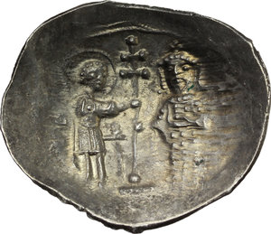 R/ Alexius I, Comnenus (1081-1118).  EL Histamenon Nomisma, Thessalonica mint. Obv. Bust of Christ facing, wearing nimbus, pallium and colobium, and holding book of Gospels. Rev. St. Demetrius standing right presenting patriarchal cross to Alexius, who stands facing; the saint is nimbate, wears military attire and holds a sword; the Emperor wears crown and loros and holds labarum. DOC 5a. Sear 1905. EL. g. 4.29  mm. 29.00  RR. Very rare and in excellent condition for the issue. EF. Cf. MIRB January 12,2009, NY, 3280, (a similar specimen) estimated $ 1250-1500.