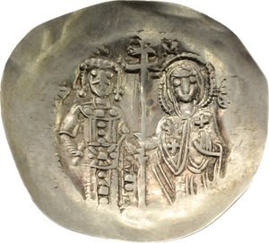 R/ Manuel I Comnenus (1143-1180).  EL Aspron Trachy, Constantinople mint. Obv. Christ, seated facing on throne without back, raising right hand in benediction and holding book of Gospels. Rev. The Virgin and Manuel, bearded, both standing facing; they hold between them patriarchal cross. B.N. 3-5. R. 2119. Sear 1958. EL. g. 1.47  mm. 25.00    About EF.