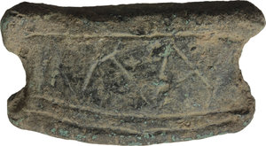 "D/ AES PREMONETALE.  Sheepskin-shaped (?) AE Cast Ingot,  decorated with geometric pattern and uncertain letters (?). Central Italy, 6th-4th century BC.    AE. g. 99.60   RRR. mm. 58x30x10. Very rare. Untouched earthen green patina. Good VF. A very rare and interesting pre-monetary item. For bronze objects found with aes rude and early bars, see ICC p.83 ff. and A. M. Murgan, ""Heavy metal in hallowed contexts. Continuity and change in aes deposits in Central Italy and Sicily"" in ""Embodying Value? The Transformation of Objects in and from the Ancient World"", BAR International Series 2592, 2014."
