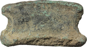 "R/ AES PREMONETALE.  Sheepskin-shaped (?) AE Cast Ingot,  decorated with geometric pattern and uncertain letters (?). Central Italy, 6th-4th century BC.    AE. g. 99.60   RRR. mm. 58x30x10. Very rare. Untouched earthen green patina. Good VF. A very rare and interesting pre-monetary item. For bronze objects found with aes rude and early bars, see ICC p.83 ff. and A. M. Murgan, ""Heavy metal in hallowed contexts. Continuity and change in aes deposits in Central Italy and Sicily"" in ""Embodying Value? The Transformation of Objects in and from the Ancient World"", BAR International Series 2592, 2014."