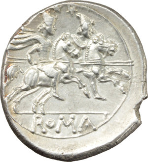 R/ Anonymous.  AR Denarius, after 211 BC. Obv. Helmeted head of Roma right; behind, X. Rev. The Dioscuri galloping right; below, ROMA in linear frame. Cr. 53/2; Cf. Cr. 198/1 (for style). AR. g. 4.07  mm. 21.50   Magnificent style and enchanting light iridescent tone, with golden hues. Exceptional. About FDC.