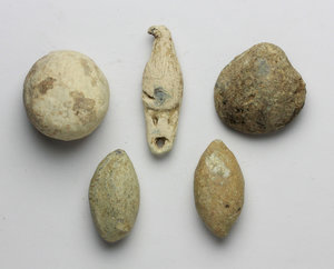 obverse: Leads from Ancient World.  Multiple lot of five (5) lead objects: a Sardo-Punic lead weight, g. 130.00; an Italic votive lead scallop-shell, g. 59.1; an Italic votive lead amphora, g. 24.18; two (2) Italic lead slingshot bullets.    PB.      VF.