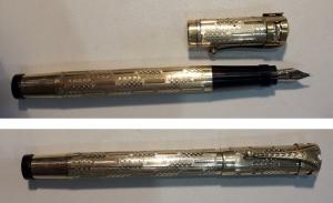 D/ Penna stilograficaIDEAL. Laminata in oro 18 kt. Pennino retrattile 14 kt. Peso 18 gr. – 12 cm. Buono. Stima:200.