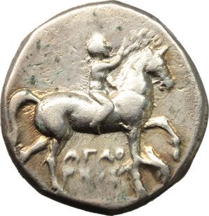 Italy. Southern Apulia, Tarentum.   AR Nomos, circa 272-240 BC. Obv. Youth on horseback right, crowning horse with wreath; AΓAΘ-A/PKOΣ in two lines below. Rev. Phalanthos riding dolphin left, holding kantharos and cornucopiae; torch to right. Vlasto 852-4. HN Italy 1028. AR. g. 6.20  mm. 21.00    VF.