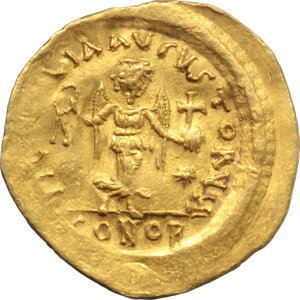 Justinian I (527-565).  AV Tremissis, Constantinople mint. Obv. DN IVSTINIANVS PP AVG. Diademed, draped and cuirassed bust right. Rev. VICTORIA AVGVSTORVM. Victory advancing right, holding wreath and globus cruciger; to right, star; in exergue, CONOB. D.O. 19. Sear 145. AV. g. 1.35  mm. 16.00   Minor areas of weakness and slight bend to flan, otherwise EF.