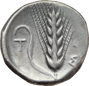 Italy. Southern Lucania, Metapontum.   AR Stater, c. 400-340 BC. Obv. Head of Demeter right, wearing fillet; [I-YΓIEIA]. Rev. Barley ear of six grains with leaf to left; to right, ME; to left, T. Cf. HN Italy 1516. Cf. Noe 413. AR. g. 7.38  mm. 22.00  R. Nicely toned. VF/Good VF.