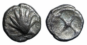 obverse image: Italy. Southern Apulia, Tarentum. AR Litra, 500-480 BC. Obv. Cockle shell. Rev. Wheel. HN Italy 853. AR. g. 0.78 mm. 8.00 Toned VF+
