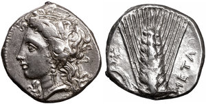 obverse image: LUCANIA. Metapontion. 330-290 BC. Nomos. 7.75 gr. - 20,00 mm. O:\ Head of Demeter left, wearing grain wreath. R:\ META; Barley ear of seven grains, with leaf to left; above leaf, Artemis-Hekate advancing right, carrying long torch; ΛY below leaf. Johnston Class C, 7; HN Italy 1590. XF+