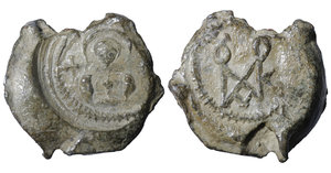 obverse image: BYZANTINE LEAD SEALS. 13.04 gr. - 27,00 mm. Romanos (Circa 6th century). O:\ Ῥωμανοῦ. R:\ Facing bust of saint; cross to left and right. XF+
