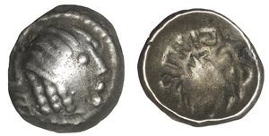 obverse image: ARABIA. Southern. Himyar.  Amdān Bayān Yahaqbiḍ. 100-120 AD. AR Fraction. 8.5 mm -0.40 g, 8h. Scyphate type with name  Amdān Bayān. Raydan mint. O:\ Head right within dotted circle interrupted by monogram to left. R:\ Small head right; 'scepter' to right. CAF 3.4iii; Huth 444; SNG ANS –. VF+ toned. Rare.
