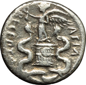 reverse: Augustus (27 B.C - 14 AD).  AR Quinarius, c. 29-27 BC. Obv. [CAESAR IMP VII]. Bare head of Octavian right. Rev. ASIA RECEPTA. Victory standing left on cista mystica flanked by two snakes. RIC 276. AR. g. 1.39  mm. 13.00    About VF/VF.