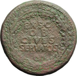 reverse: Claudius (41-54).  AE Sestertius. Obv. TI CLAVDIVS CAESAR AVG PM TR P IMP. Laureate head right. Rev. EX SC/OB/CIVES/SERVATOS in oak-wreath. RIC 96. C. 39. AE. g. 26.52  mm. 34.00   Brown patina with green and reddish hues. Good VF/VF.
