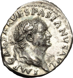 obverse: Vespasian (69-79).  AR Denarius, 69-71 AD. Obv. IMP CAESAR VESPASIAN AVG. Laureate head right. Rev. COS ITER TR POT. Pax seated left, holding branch and caduceus. RIC 10. AR. g. 3.18  mm. 20.00   Superb portrait in high relief. Glossy cabinet tone. Spots of light corrosion on reverse, otherwise  about EF.