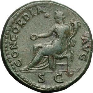 reverse: Domitian as Caesar (69-81).  AE Dupondius, Rome mint, 80-81 AD. Obv. CAES DIVI VESP DOMITIAN COS VII. Laureate head right. Rev. CONCORDIA AVG SC. Concordia seated left, holding patera and cornucopiae. RIC (Titus) 166 a. C. 39. AE. g. 15.23  mm. 28.00   A very attractive example. Dark green patina. Good VF/VF.