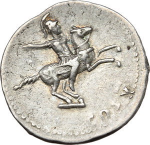 reverse: Domitian as Caesar (69-81).  AR Denarius, Rome mint, 77-78 AD. Obv. CAESAR AVG F DOMITIANVS. Laureate head right. Rev. COS V. Soldier, raising hand, on horse rearing right. RIC 242. AR. g. 3.39  mm. 18.50  R. Rare. A superb portrait, in high relief. Prettily toned, with golden hues. Good VF.