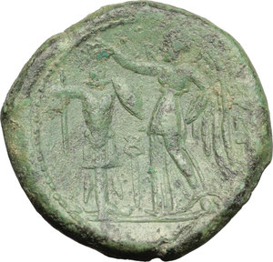 reverse: Italy. Bruttium, Brettii.   AE Double (Didrachm) Fourth coinage, c. 214-211 BC. Obv. Helmeted head of Ares left; below, grain ear. Rev. BPETTIΩN. Nike standing left, holding palm, crowning trophy to left with wreath; between, kerykeion. HN Italy 1975. Scheu, Bronze 6. AE. g. 14.46  mm. 26.50   Nice green patina. About VF/VF.