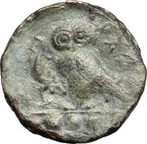 reverse: Sicily. Kamarina.   Æ Tetras or Trionkion, c. 420-405 BC. Obv. Facing gorgoneion. Rev. Owl standing left, holding lizard; three pellets in exergue. CNS II, 20. AE. g. 3.46  mm. 16.00    VF.