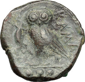 reverse: Sicily. Kamarina.   Æ Tetras or Trionkion, c. 420-405 BC. Obv. Helmeted head of Athena left. Rev. Owl standing right, holding lizard; three pellets in exergue. CNS II, 33. AE. g. 3.11  mm. 15.00    VF.