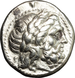 obverse: Greece. Kings of Macedon. Philip II (359-336 BC).  AR Tetradrachm, Amphipolis mint. Struck under Kassander, Philip IV or Alexander, c. 310-294 BC. Obv. Laureate head of Zeus right.  Le Rider pl. 47,15. SNG ANS 778. AR. g. 14.08  mm. 25.00    Good VF/VF.