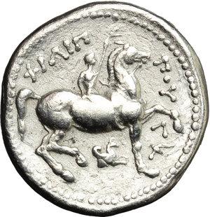 reverse: Greece. Kings of Macedon. Philip II (359-336 BC).  AR Tetradrachm, Amphipolis mint. Struck under Kassander, Philip IV or Alexander, c. 310-294 BC. Obv. Laureate head of Zeus right.  Le Rider pl. 47,15. SNG ANS 778. AR. g. 14.08  mm. 25.00    Good VF/VF.