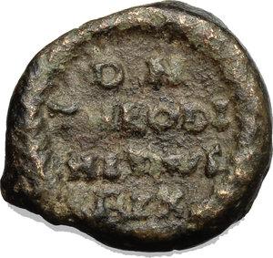 reverse: Ostrogothic Italy, Theodahad (534-536).  AE Decanummium, Rome mint. Obv. INVIC[TA ROMA]. Helmeted and cuirassed bust of Roma right. Rev. DN/THEODI (sic)/ HITHVS (sic)/ RIX in four lines; all within wreath. Ranieri 290-292 (Ravenna) var. (reverse legend). MIB 82 var (same). Wroth 16 var. (same). AE. g. 4.43  mm. 17.50  R.  F/About VF.