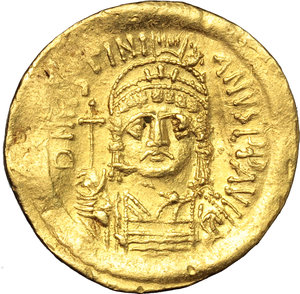 obverse: Justinian I (527-565).  AV Solidus, Constantinople mint. Obv. DN IVSTINIANVS PP AVG. Helmeted and cuirassed bust facing, holding globus cruciger and shield. Rev. VICTORIA AVGGG Θ. Angel standing facing, holding long staff surmounted by simplified Christogram and globus cruciger; to right, star; in exergue, CONOB. D.O. 9. Sear 140. AV. g. 4.50  mm. 20.50   Minor area of flatness and slightly bend, otherwise good VF.