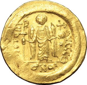reverse: Justinian I (527-565).  AV Solidus, Constantinople mint. Obv. DN IVSTINIANVS PP AVG. Helmeted and cuirassed bust facing, holding globus cruciger and shield. Rev. VICTORIA AVGGG Θ. Angel standing facing, holding long staff surmounted by simplified Christogram and globus cruciger; to right, star; in exergue, CONOB. D.O. 9. Sear 140. AV. g. 4.50  mm. 20.50   Minor area of flatness and slightly bend, otherwise good VF.