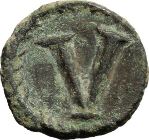 reverse: Justinian I (527-565).  AE Pentanummium, Rome mint. Obv. Diademed, draped and cuirassed bust right. Rev. Large V within wreath. D.O. 327. R. 729. Sear 309. AE. g. 1.84  mm. 12.00   Green brown patina. Good VF/About EF.
