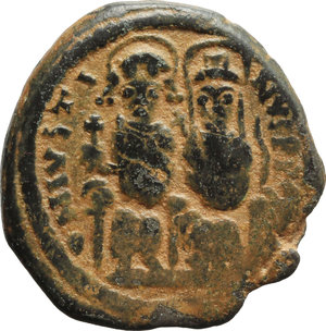 obverse: Justin II (565-578).  AE Follis, Nicomedia mint. Obv. Justin and Sophia seated facing on double throne. Rev. Large M between A/N/N/O and GI/II; above, cross; beneath, B; in exergue, NIKO. D.O. 92-103. Sear 369. AE. g. 13.29  mm. 28.00   Lovely dark green patina with reddish earthen deposits. VF.