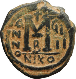 reverse: Justin II (565-578).  AE Follis, Nicomedia mint. Obv. Justin and Sophia seated facing on double throne. Rev. Large M between A/N/N/O and GI/II; above, cross; beneath, B; in exergue, NIKO. D.O. 92-103. Sear 369. AE. g. 13.29  mm. 28.00   Lovely dark green patina with reddish earthen deposits. VF.