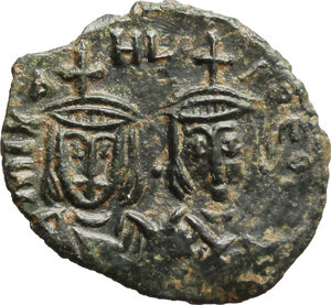 obverse: Michael II, the Amorian (820-829).  AE Follis, Syracuse mint. Obv. Facing busts of Michael and his son Theophilus. Rev. Large M, cross above, Θ beneath. D.O. 21. Sear 1652. AE. g. 2.33  mm. 20.00   Nice glossy dark green patina. About EF.