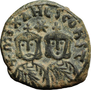 obverse: Theophilus (829-842).  AE Follis, Syracuse mint. Obv. Bust facing, wearing crown and loros, and holding cross potent. Rev. Facing busts of Michael II (the emperor s deceased father) and Constantine (his deceased son); between their heads, star. D.O. 29. Sear 1680. AE. g. 4.46  mm. 20.00  Scarce. A very attractive example. Dark olive-green patina, lighter on fields. Good VF.