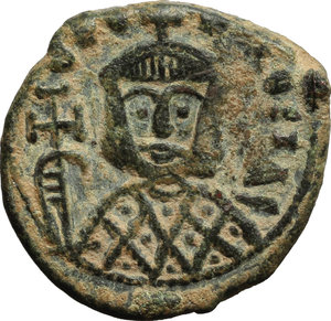 reverse: Theophilus (829-842).  AE Follis, Syracuse mint. Obv. Bust facing, wearing crown and loros, and holding cross potent. Rev. Facing busts of Michael II (the emperor s deceased father) and Constantine (his deceased son); between their heads, star. D.O. 29. Sear 1680. AE. g. 4.46  mm. 20.00  Scarce. A very attractive example. Dark olive-green patina, lighter on fields. Good VF.