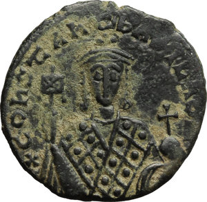 obverse: Constantine VII (913-959) and Romanus I (920-944).  AE Follis, Constantinople mint. Obv. Facing busts of Constantine VII, beardless, holding labarum and globus cruciger. Rev. Legend in four lines. D.O. 23. Sear 1759. AE. g. 6.06  mm. 24.50  Scarce. Dark green tone with lighter spots. VF.