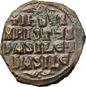 reverse: Basil II and Constantine VIII (976-1025).  AE Anonymous Follis (Class A 2). Constantinople mint. Obv. Bust of Christ facing, wearing nimbus, pallium and colobium and holding book of Gospels with both hands. Rev. Legend in four lines. DOC Class A2. Sear 1813. AE. g. 10.20  mm. 27.00   An outstanding example, in exceptional condition for issue. Glossy brown tone. EF.