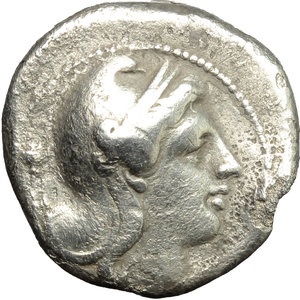 obverse:   AR Didrachm, Rome mint, c. 265-242 BC. Obv. Head of Roma right, wearing Phrygian helmet; behind, uncertain symbol. Rev. ROMANO. Victory standing right, attaching wreath to palm branch; to right, XX. Cr. 22/1. AR. g. 6.23  mm. 19.00  RR. Very rare. Slight bend on edge from about 3 to 4 o clock. About VF.