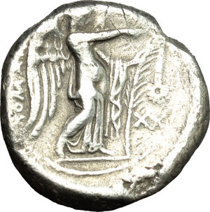 reverse:   AR Didrachm, Rome mint, c. 265-242 BC. Obv. Head of Roma right, wearing Phrygian helmet; behind, uncertain symbol. Rev. ROMANO. Victory standing right, attaching wreath to palm branch; to right, XX. Cr. 22/1. AR. g. 6.23  mm. 19.00  RR. Very rare. Slight bend on edge from about 3 to 4 o clock. About VF.