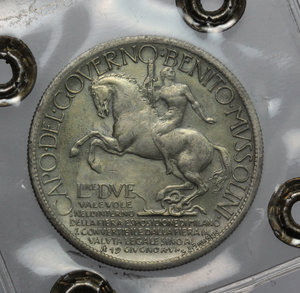 reverse: Regno di Italia. Vittorio Emanuele III (1900-1943). 2 lire 1928  Fiera di Milano .    Mont. 09. Metallo dorato (senza doratura).      BB. Perizia Bazzoni.
