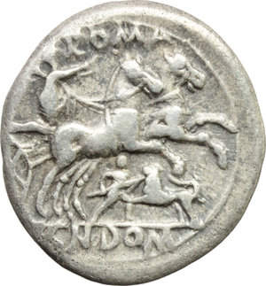 reverse: Cn. Domitius Ahenobarbus.  AR Denarius, 128 BC. Obv. Helmeted head of Roma right; behind, corn-ear; before, X. Rev. Victory in biga right, holding reins and whip; above, ROMA; below, man fighting lion (or hound?); in exergue, CN DOM. Cr. 261/1. B. 14. AR. g. 3.81  mm. 19.00   Pleasant and nicely toned. VF.