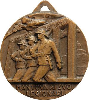reverse: Benito Mussolini (1883-1945), Duce d Italia. Medaglia con appiccagnolo A.XV  Mantova ai suoi Legionari.    Cas.manca. AE.   mm. 44.00 Inc. Monti. R.