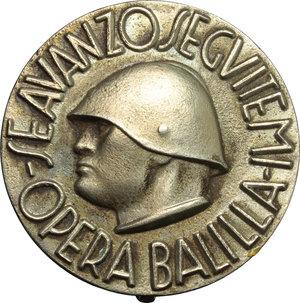 obverse: Benito Mussolini (1883-1945), Duce d Italia. Spilla Opera Balilla.  D/ SE AVANZO SEGUITEMI.   MB.   mm. 38.00    SPL+.