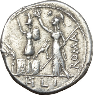 reverse: M. Furius L.f. Philus.  AR Denarius, 119 BC. Obv. M. FOVRI. L. F around laureate head of Janus. Rev. Roma standing left, wearing Corinthian helmet and holding sceptre, crowning trophy flanked by a carnyx and shield on each side; above her head, star; to right, ROMA; in exergue, PHLI. Cr. 281/1. B. 18. AR. g. 3.72  mm. 19.50   Great metal and broad flan. In excellent condition for the issue, brilliant and lightly toned. About EF/Good VF.