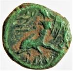 reverse: Mondo Greco. Calabria. Brundisium. 215-214 a.C. Semuncia. Ae. D/ Testa di Poseidone a destra, dietro un tridente. R/ Giovane su delfino a sinistra, tiene con la mano destra un kantaros e con il braccio sinistro una lyra, nel campo a destra