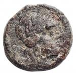 obverse: Mondo Greco - Sicilia Katane. III sec. a.C.Ae. D/ Testa di Apollo verso sinistra. R/ Isis verso destratiene un uccello, etnico. SNG ANS 1284. Peso 3,78 gr. Diametro 15,35 mm.MB+