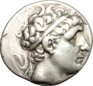 Greek Asia.Ionia, Magnesia ad Maeandrum.Antiochos II. Theos (286-246 BC). AR Tetradrachm, 261-246 BC.Obv. Diademed head of Antiochos I right.Rev. Apollo Delphios, naked, holding bow, seated on omphalos left.SC 540/1.AR.g. 16.71 mm. 29.00Testing marks on reverse.VF.