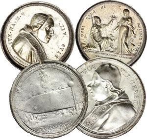 obverse:  Lotto di 4 lamine in argento: Pio VI, rovescio di medaglia del  600; Pio VII, D/ e R/ di medaglia dell anno XVI;  Benedetto XIV, D/ di medaglia dell anno XII.     AG.