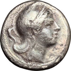 obverse: Anonymous.  AR Didrachm, c. 265-242 BC, Neapolis mint. Obv. Head of Roma right, wearing Phrygian helmet; behind, cornucopiae. Rev. ROMANO. Victory standing right, attaching wreath to palm-branch; in right field, uncertain Greek letter. Cr. 22/1. HN Italy 295. AR. g. 6.33  mm. 19.00  RR. Very rare. Old cabinet tone with iridescent hues. VF.
