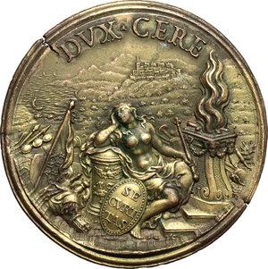 reverse: Livio Odescalchi (1652-1713). Medaglia 1685 per il rafforzamento del castello di Ceri.  D/ LIVIVS ODESCALCVS INNO XI NEP. Busto a destra; nel taglio del braccio, lupa con i gemelli; sotto, HAMERANVS. R/ DVX CERE. Allegoria della Sicurezza seduta accanto ad un'ara accesa e attorniata da trofei d'armi; ai suoi piedi, scudo inscritto SECVRITAS. In lontananza, le fortificazioni di Ceri ed il mare.  AE dorato.   mm. 43.00 Inc. Giovanni Hamerani.  Tondello fratturato. SPL/qSPL.